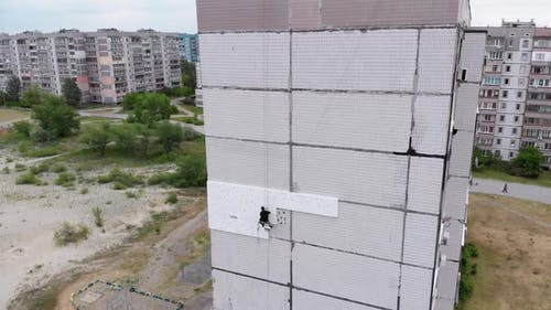 Industrial Alpinism. Aerial View. Work on Outer Insulate Building with Styrofoam