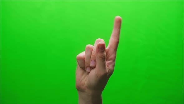 Closeup of a Hand Gesture on a Green Background Shooting a Gesturing in Studio Shaking Finger at