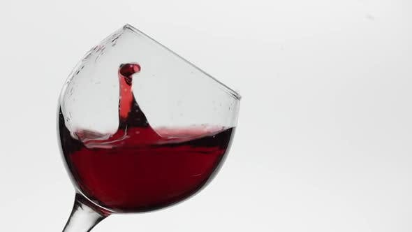 Thumbnail for Close Up of a Drop Falling in Glass with Red Wine. Rose Wine on White Background