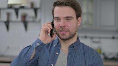 Portrait of Beard Young Man Talking on Smartphone