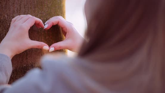 Thumbnail for Woman Make Heart Shape with Hands in Forest