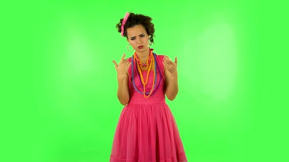 Thumbnail for Young Girl Thinks About Something, and Then an Idea Comes To Her Against Green Screen