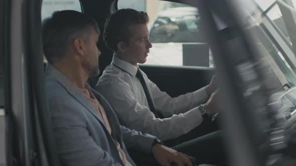 Thumbnail for Dealership Salesman Showing Interior of Car to Customer