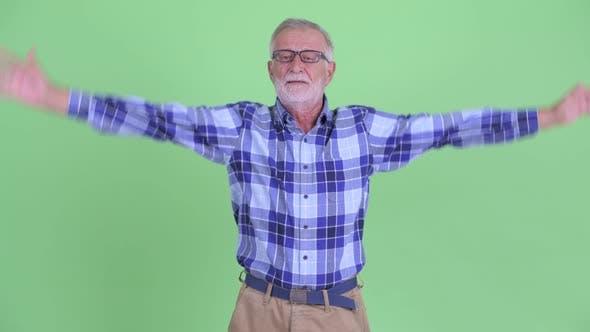 Thumbnail for Happy Senior Bearded Hipster Man Explaining Something