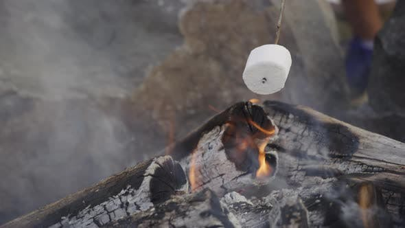 Thumbnail for Closeup of marshmallows roasting on campfire