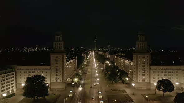 Thumbnail for Aerial View of Empty Karl-Marx-Allee Street at Night Towards Alexander Platz TV Tower in Berlin