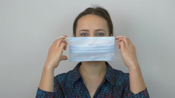 Thumbnail for Portrait of woman is putting on medical mask for virus infection prevention and protection.
