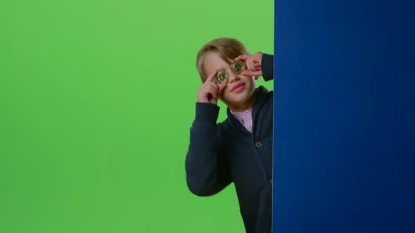 Thumbnail for Teen Comes Out From Behind the Wall with Two Coins on a Green Screen