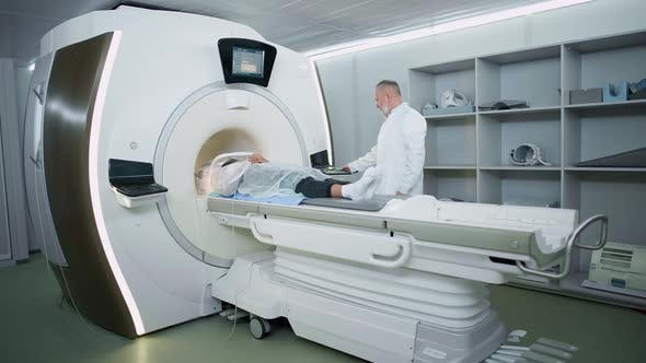 Magnetic Resonance Imaging in the Modern Hospital Adult Man Doctor Performs a Magnetic Tomographic