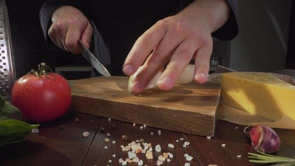 Thumbnail for Chef Chops the Onions on the Wooden Board at the Kitchen, Raw Vegetables