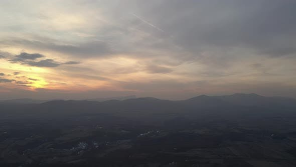 Thumbnail for Beautiful colors of dawn above Eastern Serbian landscape 4K drone footage