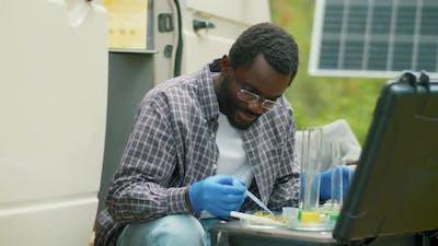 Black Man Doing Chemical Tests