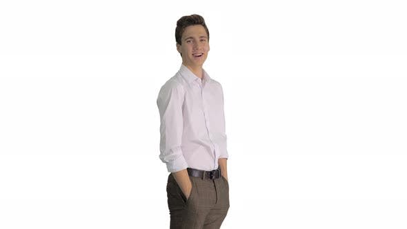 Young Man in White Shirt Laughing Really Hard on White Background
