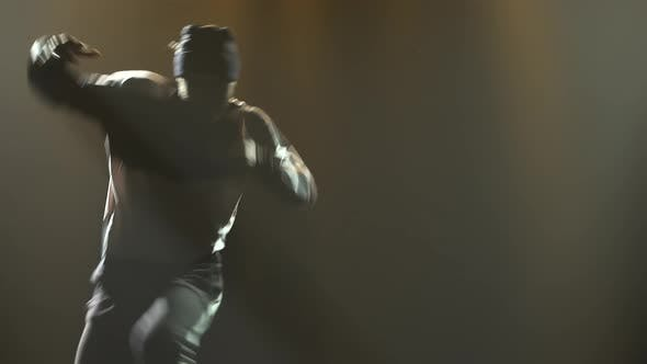 Thumbnail for Stylish Young Man Alone Dancing Street Breakdance, Hip Hop in the Studio. Silhouette of a Man