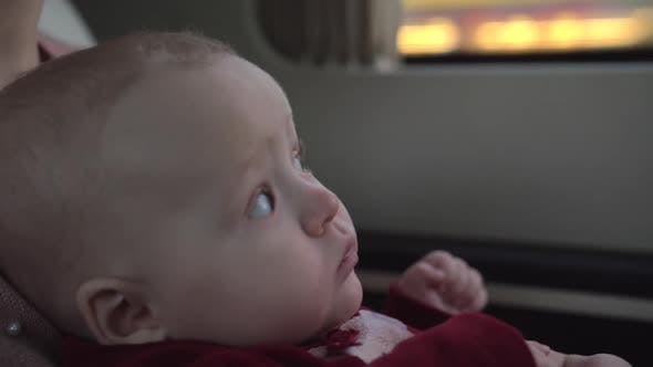 Cute Baby Girl of Six Months Traveling with Mum By Car