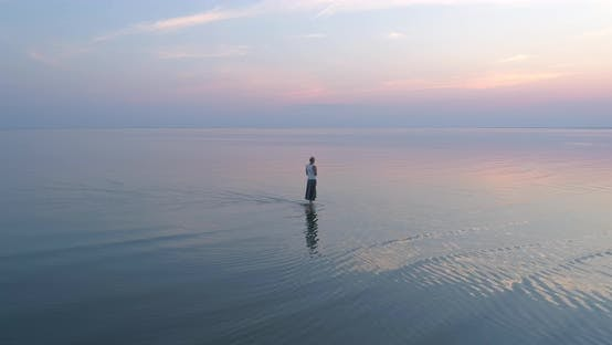 Thumbnail for Woman Walking in Sea Slow Motion