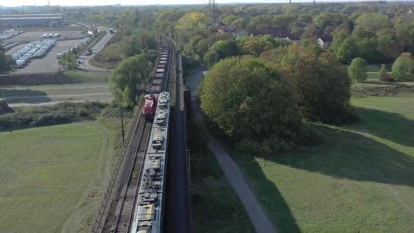 Commuter Train Stopped to Allow a Freight Train to Pass