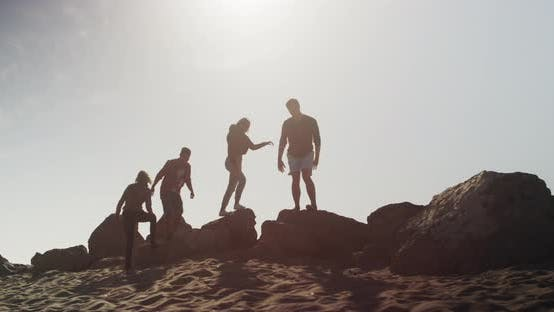 Thumbnail for Group of friends exploring rocks at the beach
