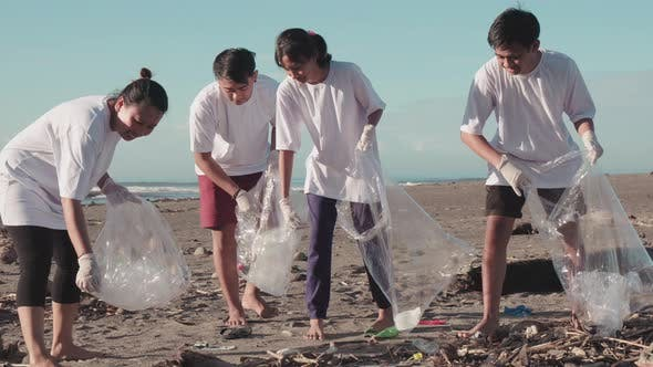 People Cleaning Beach From Garbage