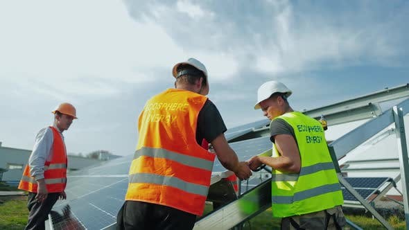 Thumbnail for Workers in Special Uniform Installing Solar Batteries