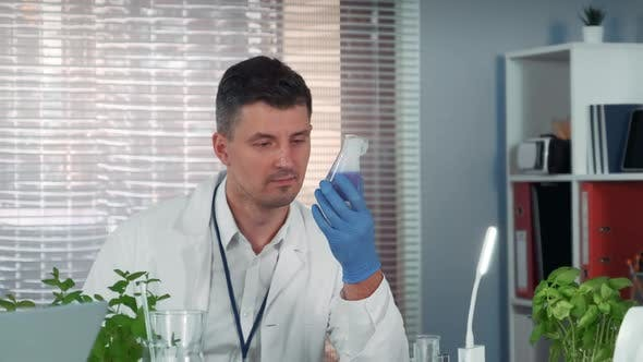 Thumbnail for Handsome Research Scientist Observing the Liquid Reaction in Conical Flask During the Experiment