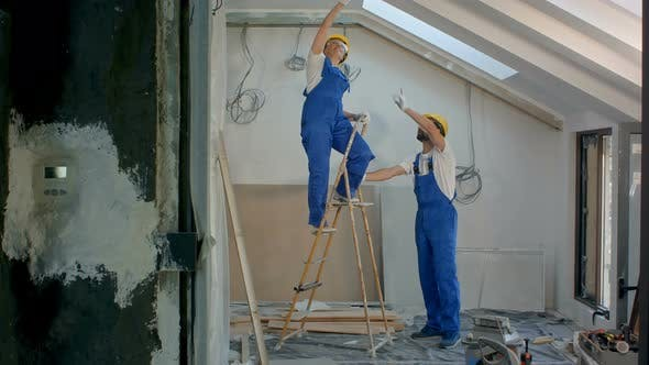Thumbnail for Two Workers with Ladder While Making Repairs To Building