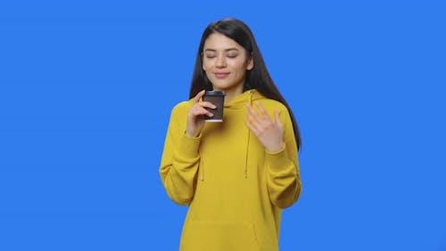 Portrait of Pretty Brunette Enjoying Coffee