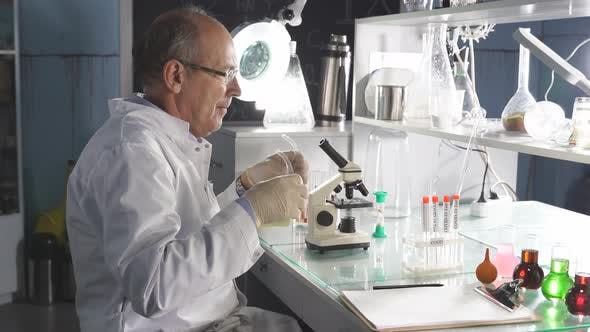Male Scientist Working in Modern Lab Making Research and Studying