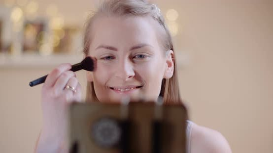 Thumbnail for Attractive Female Doing Makeup Applaying Powder Witha Brush