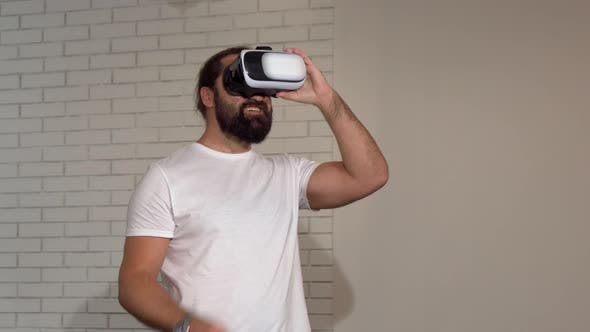 Cover Image for Handsome Bearded Mature Man Enjoying Using 3d Vr Glasses for the First Time