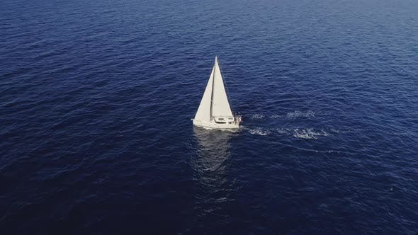 Thumbnail for Drifting Sailboat on Open Waters