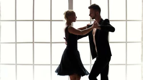 Man and Woman Dancing Together