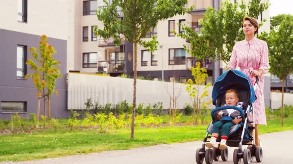 Thumbnail for Mother with Baby in Stroller Walking Along City