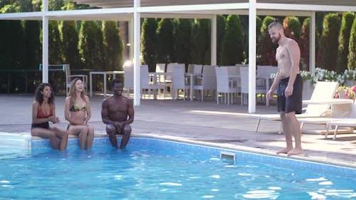 Joyful Young People Having Fun in Swimming Pool