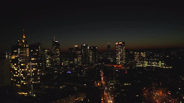 Thumbnail for AERIAL: View of Frankfurt Am Main, Germany Skyline at Nights with City Lights
