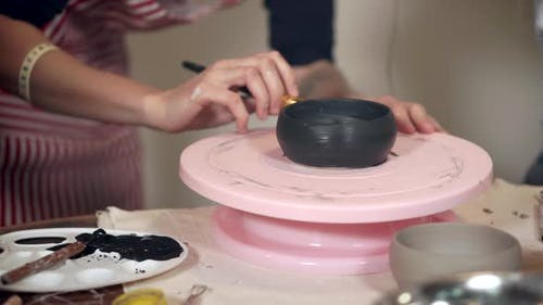 Woman on Pottery Master Class.