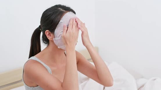 Thumbnail for Woman apply face mask with finger massage