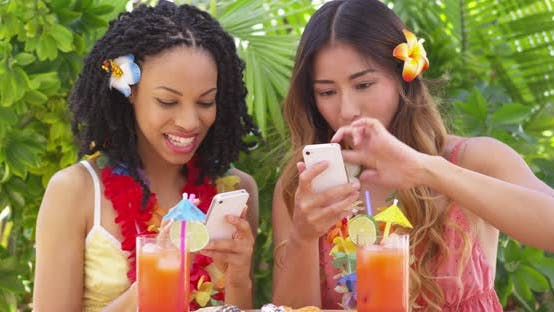 Thumbnail for Two fun girls taking selfie on tropical vacation