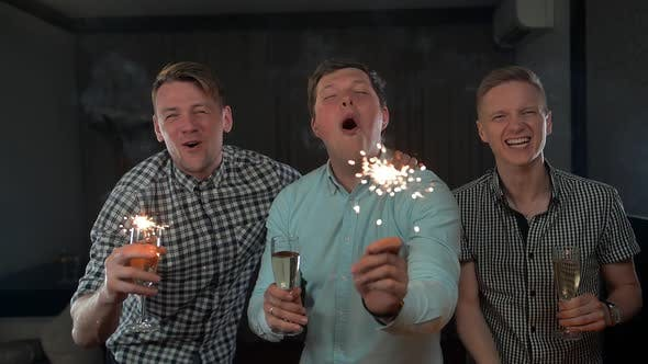 Thumbnail for Happy Young Men Holding Sparkles