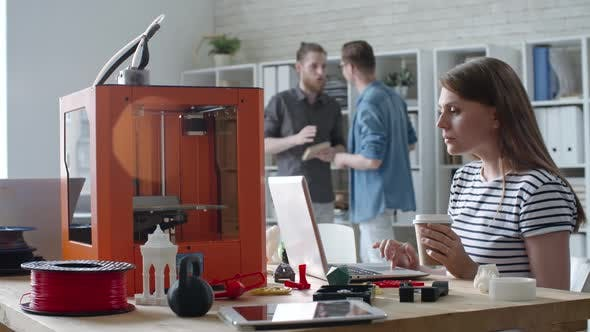 Thumbnail for Female Engineer Working on Laptop during 3D Printing