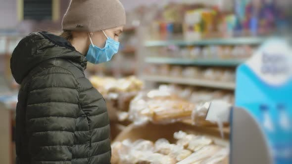 Woman in Medical Mask at the Supermarket