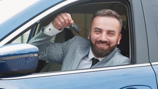 Cheerful Man Rejoicing Buying New Car and Showing Keys
