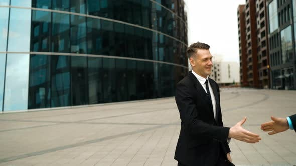 Thumbnail for Two Businessman Shaking Hands