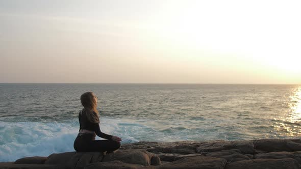 Thumbnail for Girl Meditates in Yoga Pose Against Rising Summer Sun