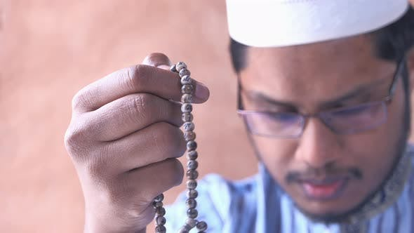 Thumbnail for Close Up of Muslim Man Praying During Ramadan,