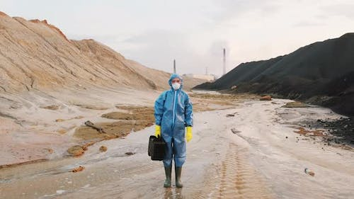 Portrait Of Ecology Expert In Protective Suit