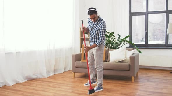 Thumbnail for Man in Headphones with Broom Cleaning at Home 113