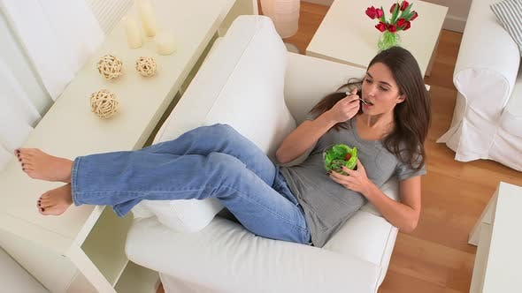Thumbnail for Happy woman smiling and eating healthy salad