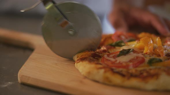 Cutting pizza into slices