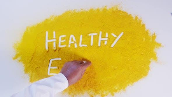 Thumbnail for Hand Writes On Turmeric Healthy Eating